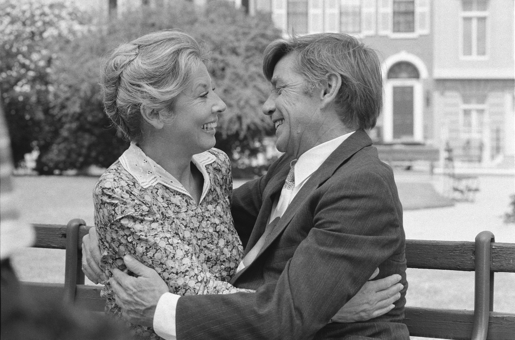 (L-R) Michael Learned as Olivia Walton and Ralph Waite as John Walton, facing each other, embracing