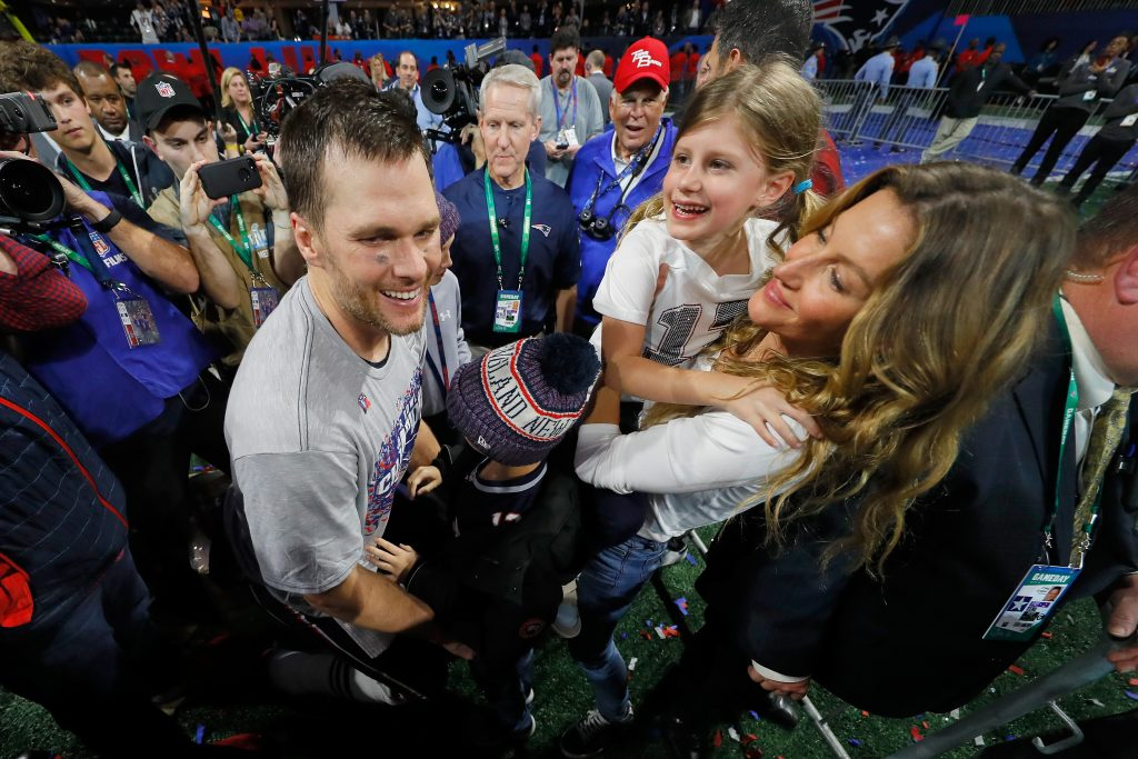 Tom Brady celebrates with wife Gisele Bundchen and children