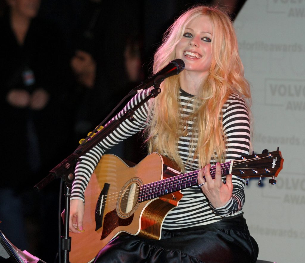 Avril Lavigne with a guitar