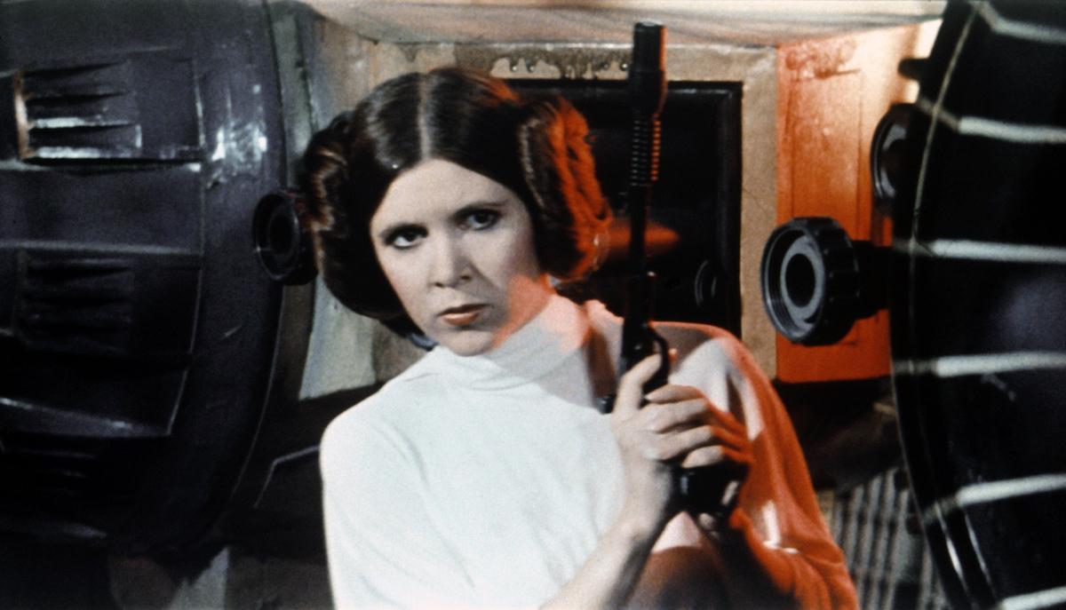 Carrie Fisher as Princess Leia holding gun