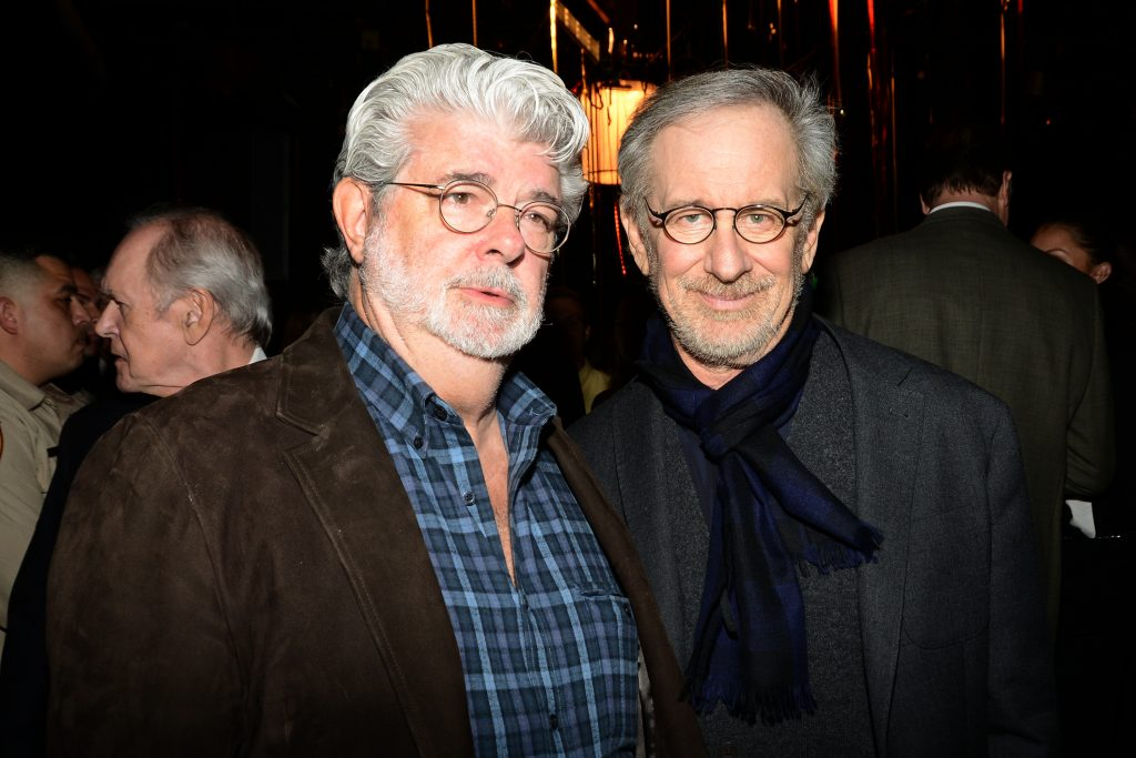 George Lucas of Star Wars fame and Steven Spielberg of Jaws fame in front of other eople