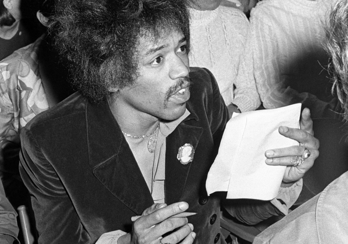 Hendrix holding a pencil and piece of paper