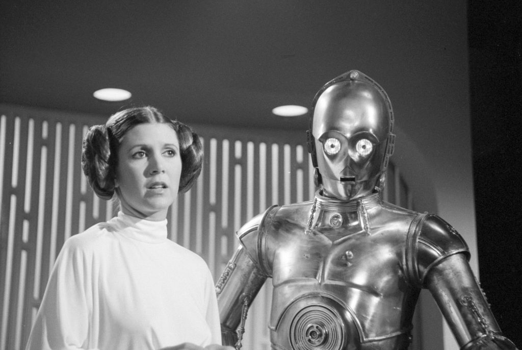 Carrie Fisher as Princess Leia with C-3PO in a scene from George Lucas' Star Wars saga