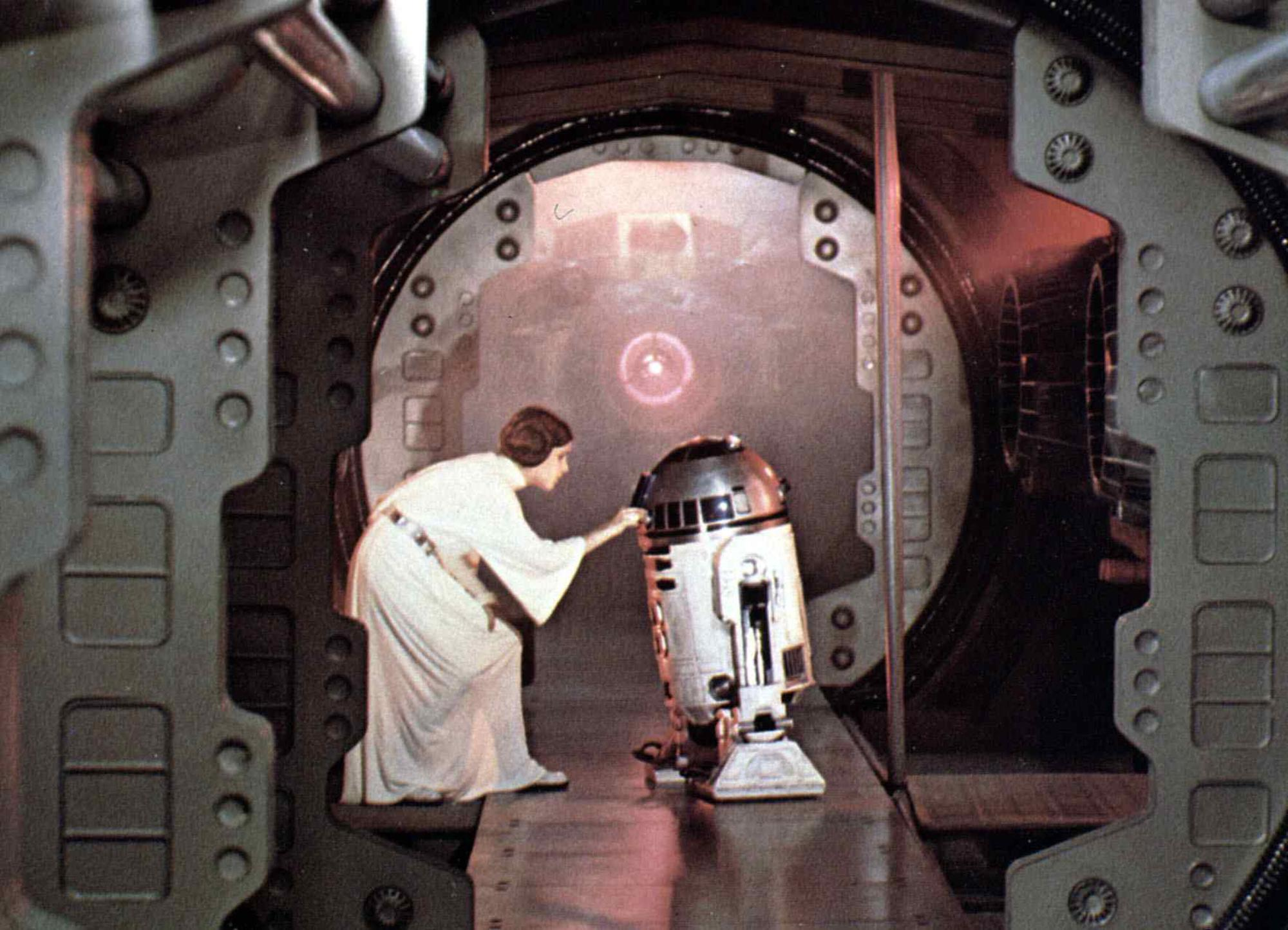 Carrie Fisher as Princess Leia and R2-D2 (Kenny Baker) in 'Star Wars: Episode IV — A New Hope'