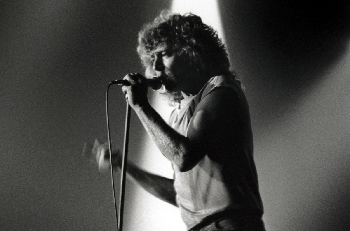 Robert Plant singing on stage in 1980