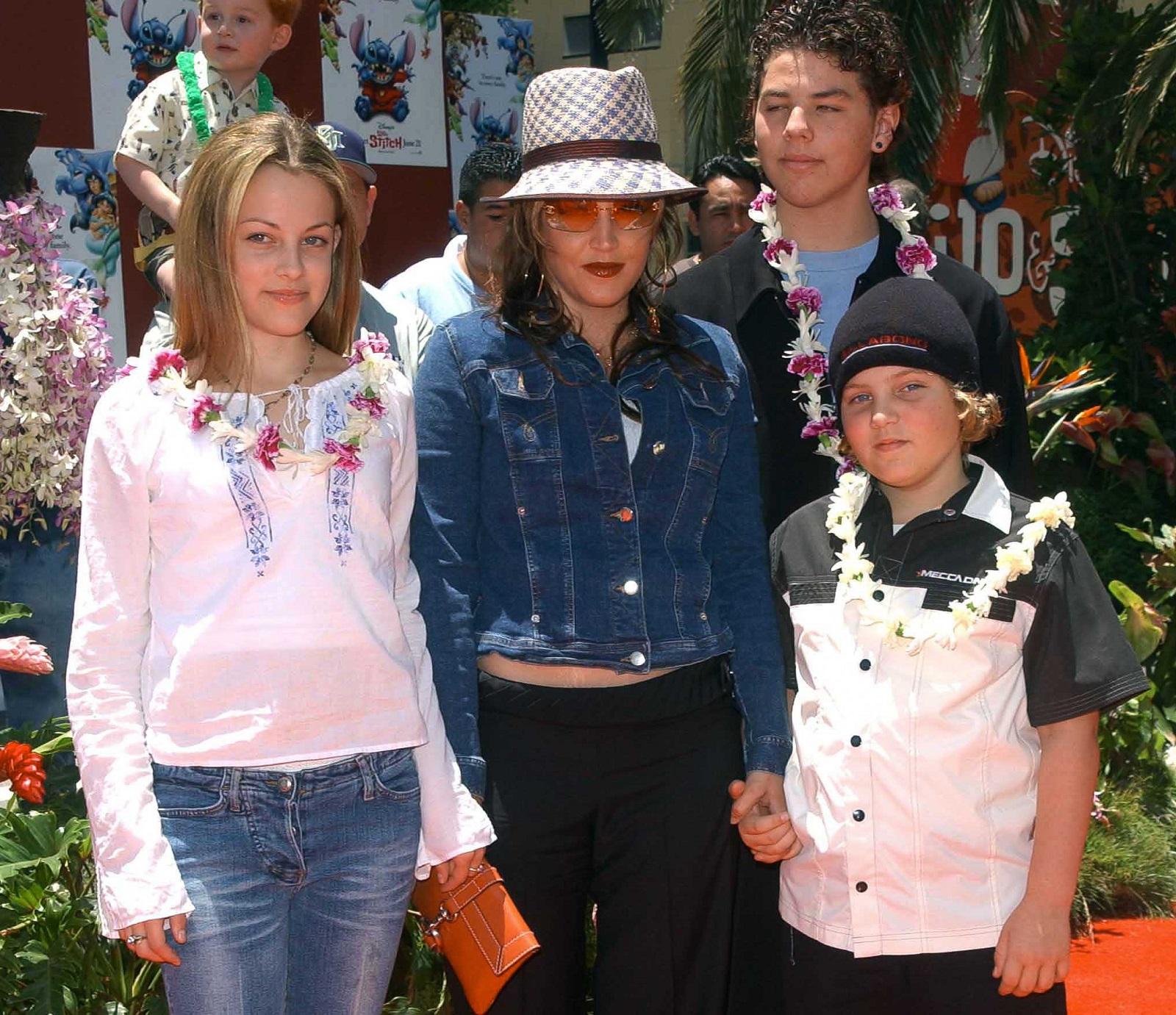 Lisa Marie Presley and her children Benjamin Keough (R), Riley Keough (L), and her half-brother Navarone Garibaldi