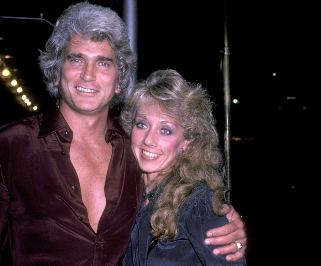Michael Landon and girlfriend Cindy Clerico on November 21, 1982 pose for photographs outside the Sherry Netherlands Hotel in New York City