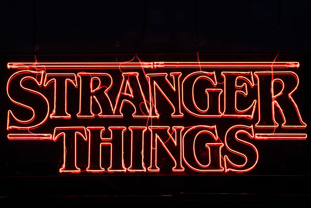 A Stranger Things logo with a black background