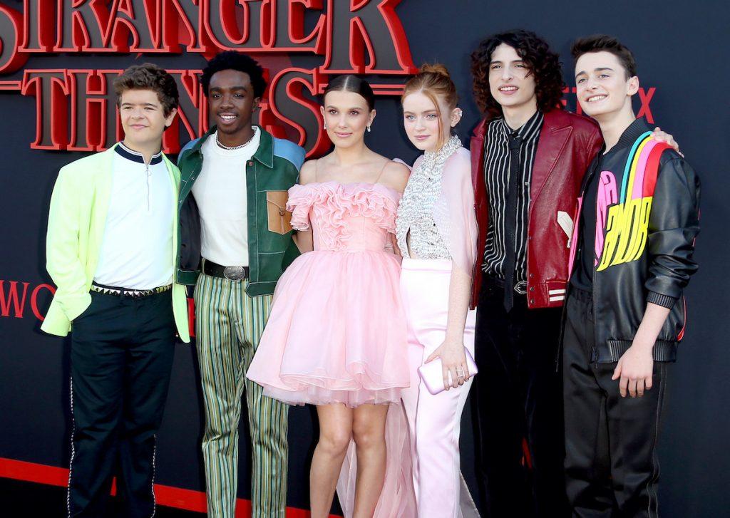 Gaten Matarazzo, Caleb McLaughlin, Millie Bobby Brown, Sadie Sink, Finn Wolfhard, and Noah Schnapp attend the premiere of Netflix's 'Stranger Things'