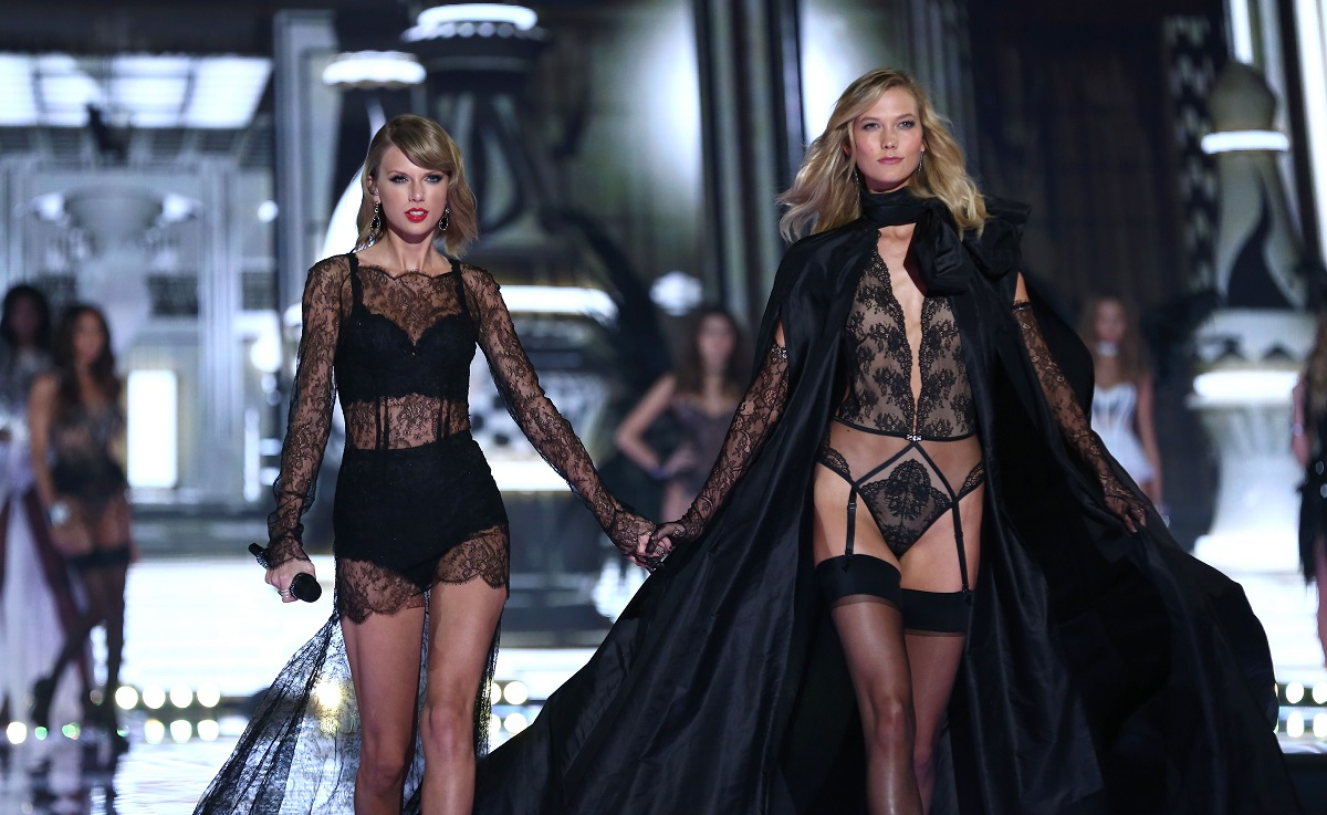 Taylor Swift and Karlie Kloss walk the runway at the annual Victoria's Secret fashion show on December 2, 2014 in London, England.