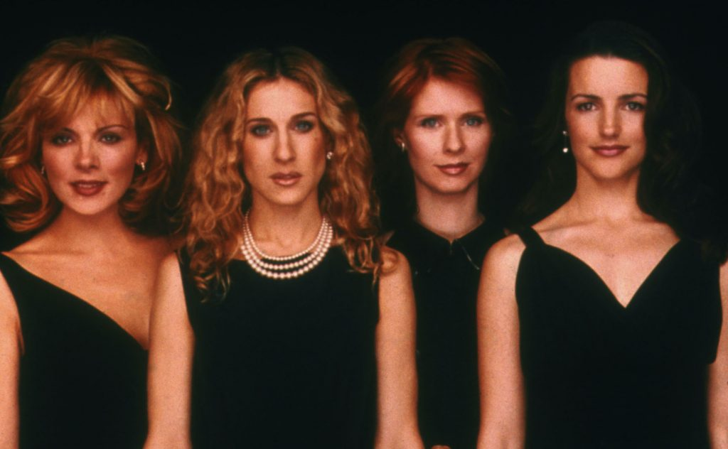 """Left to right, actresses Kim Cattrall, Sarah Jessica Parker, Cynthia Nixon, and Kristin Davis pose for a portrait in an undated photo on the set of the HBO series """"Sex and the City""""   HBO/Getty Images"""
