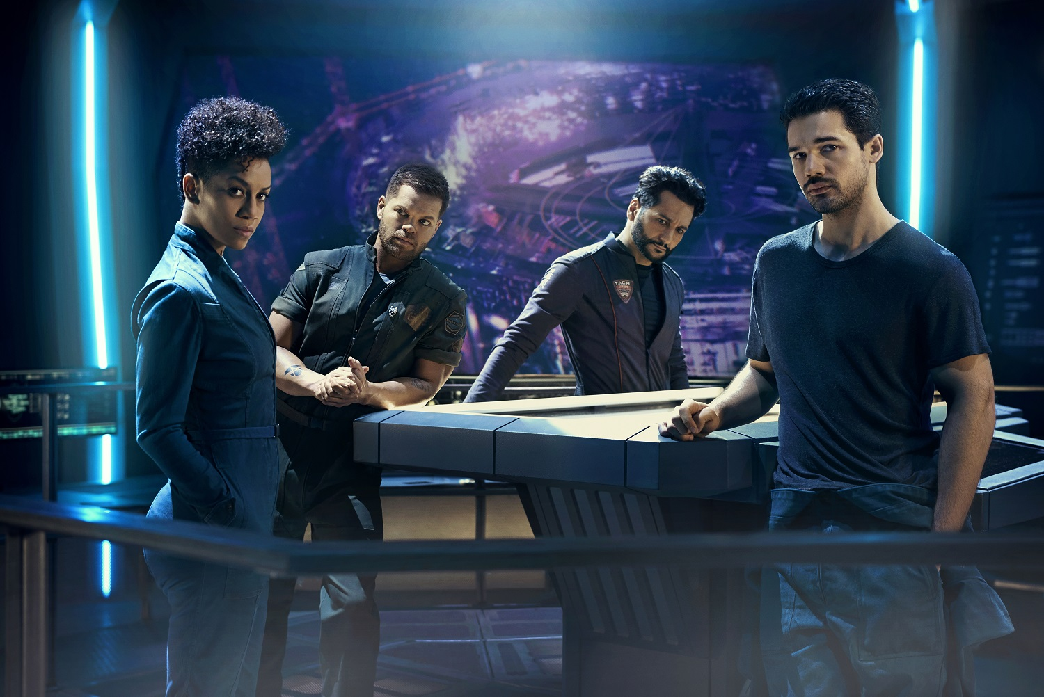 Dominique Tipper as Naomi Nagata, Wes Chatham as Amos Burton, Cas Anvar as Alex Kamal, and Steven Strait as James Holden on The Expanse