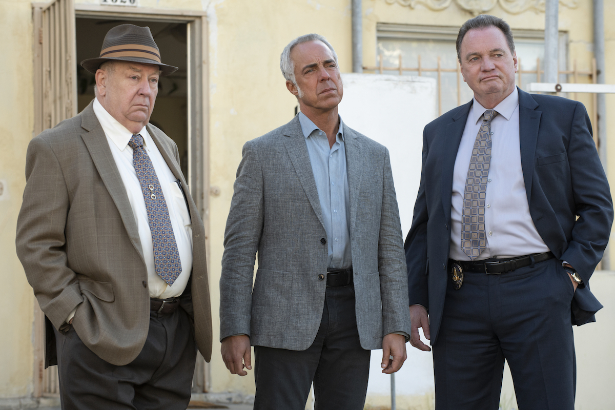 Titus Welliver as Harry Bosch flanked by two other police officers