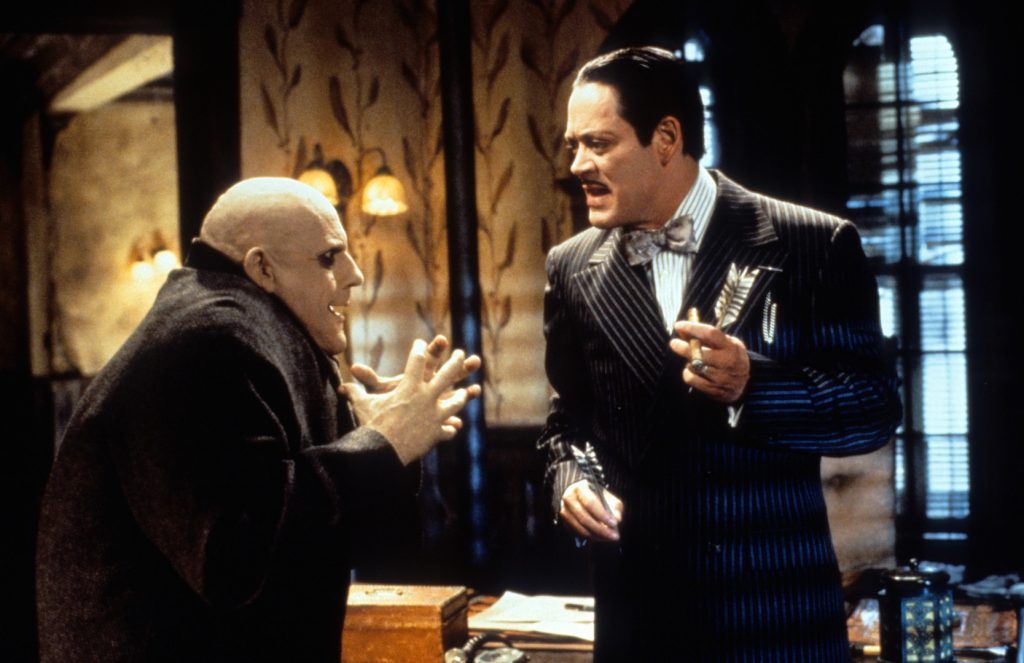 Christopher Lloyd and Raul Julia talking in a scene from the movie 'Addams Family Values'