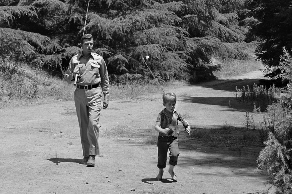 Andy Griffith as Sheriff Andy Taylor and Ron Howard as his son Opie walking to the fishing hole on 'The Andy Griffith Show'