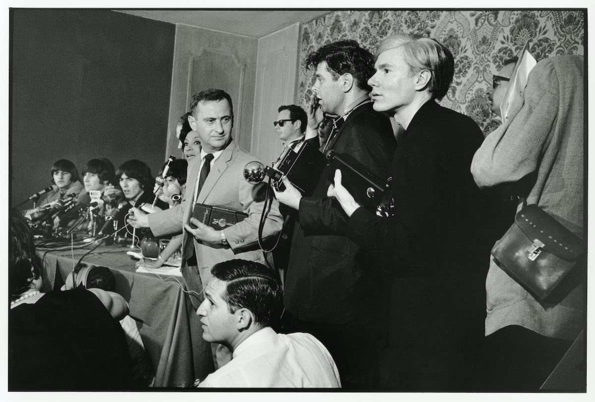 The Beatles being interviewed by the media with Andy Warhol