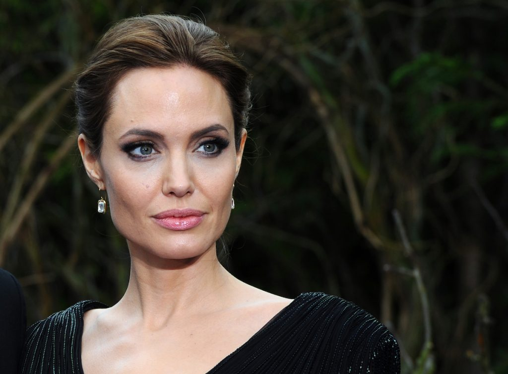 """Angelina Jolie attends a private reception as costumes and props from Disney's """"Maleficent"""" are exhibited in support of Great Ormond Street Hospital at Kensington Palace on May 8, 2014 in London, England."""