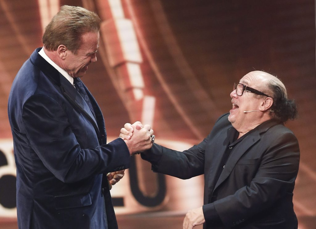 Arnold Schwarzenegger and Danny DeVito on stage