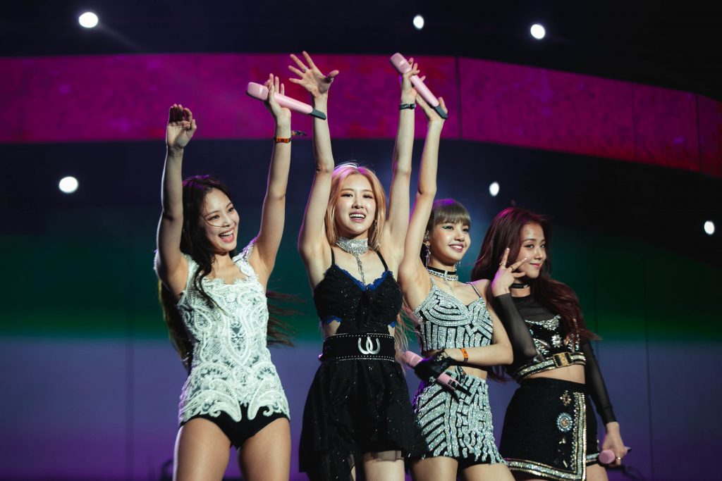 Jisoo, Jennie, Rosé, and Lisa of BLACKPINK smile and pose while performing at Coachella