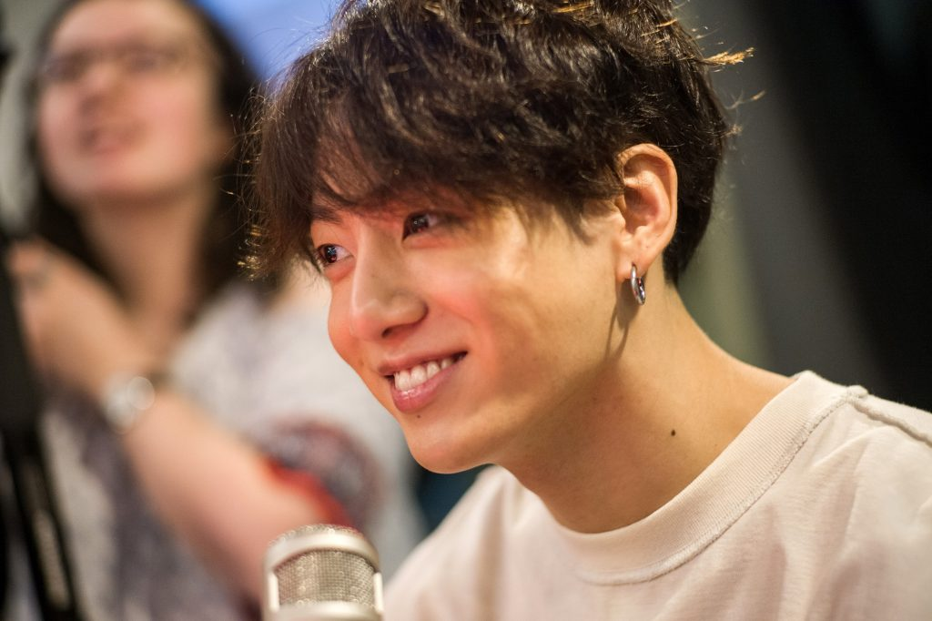 Jungkook of BTS smiles while visiting The Elvis Duran Z100 Morning Show