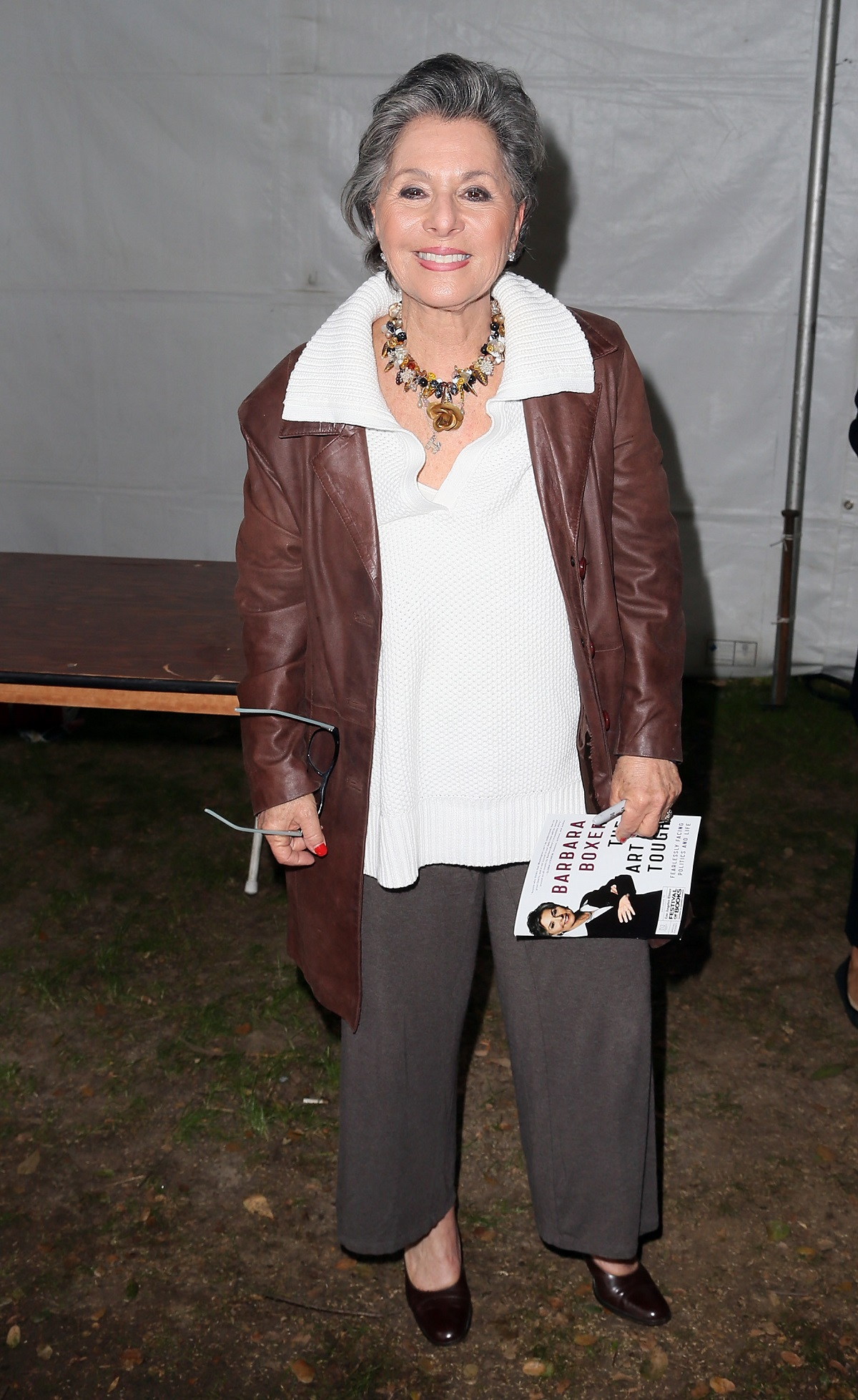 Barbara Boxer holding her book at the Los Angeles Times Book Fair