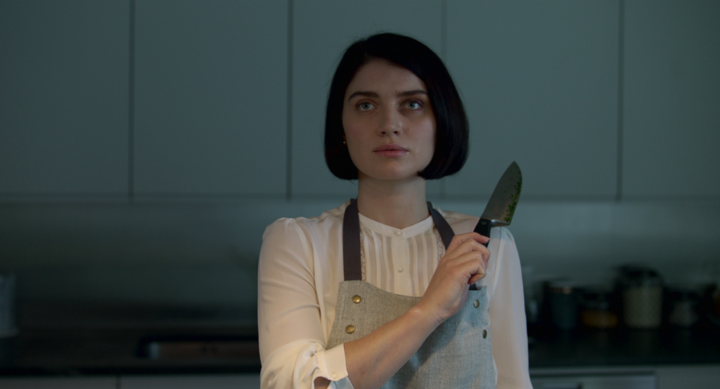 Eve Hewson as Adele holds up a knife in 'Behind Her Eyes; season 1