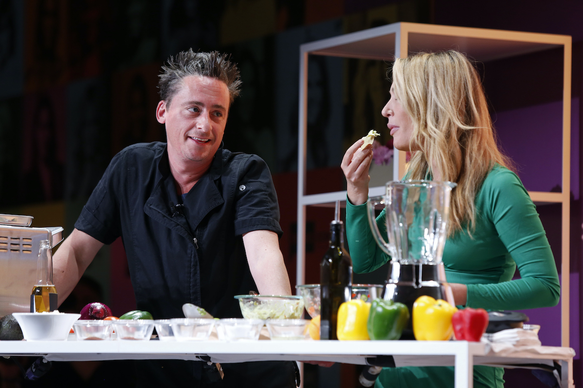 Chef Ben Robinson and Kate Chastain sample food at BravoCon