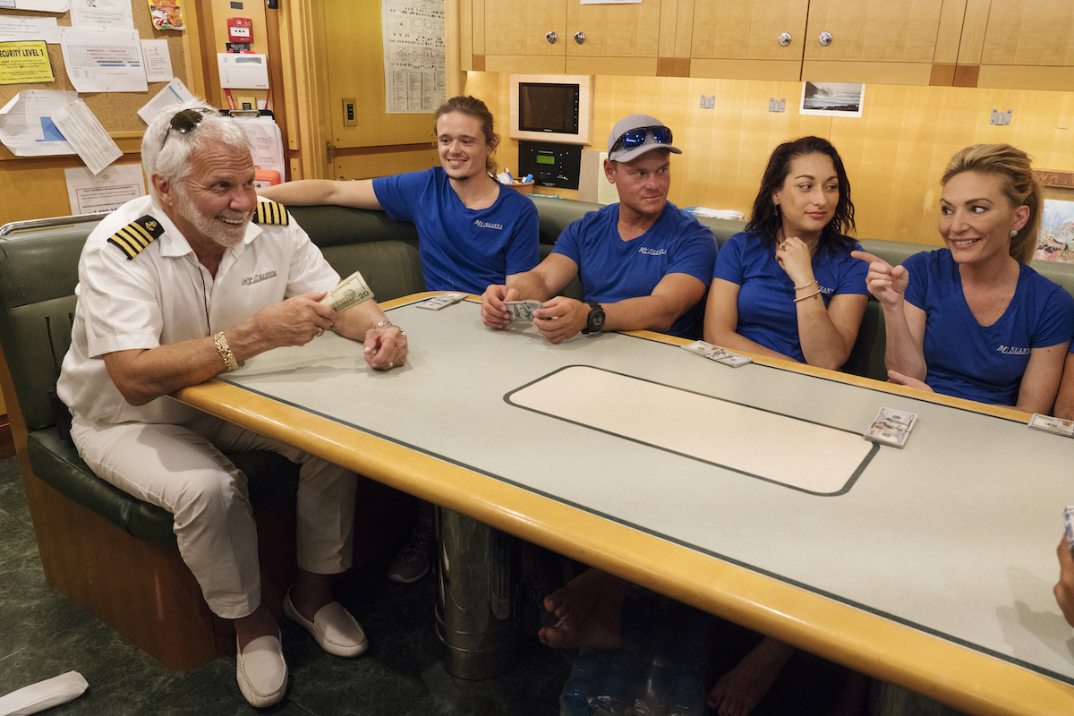 Captain Lee Rosbach, Adrian Martin, Ashton Pienaar, Laura Betancourt, Kate Chastain from 'Below Deck' getting a tip