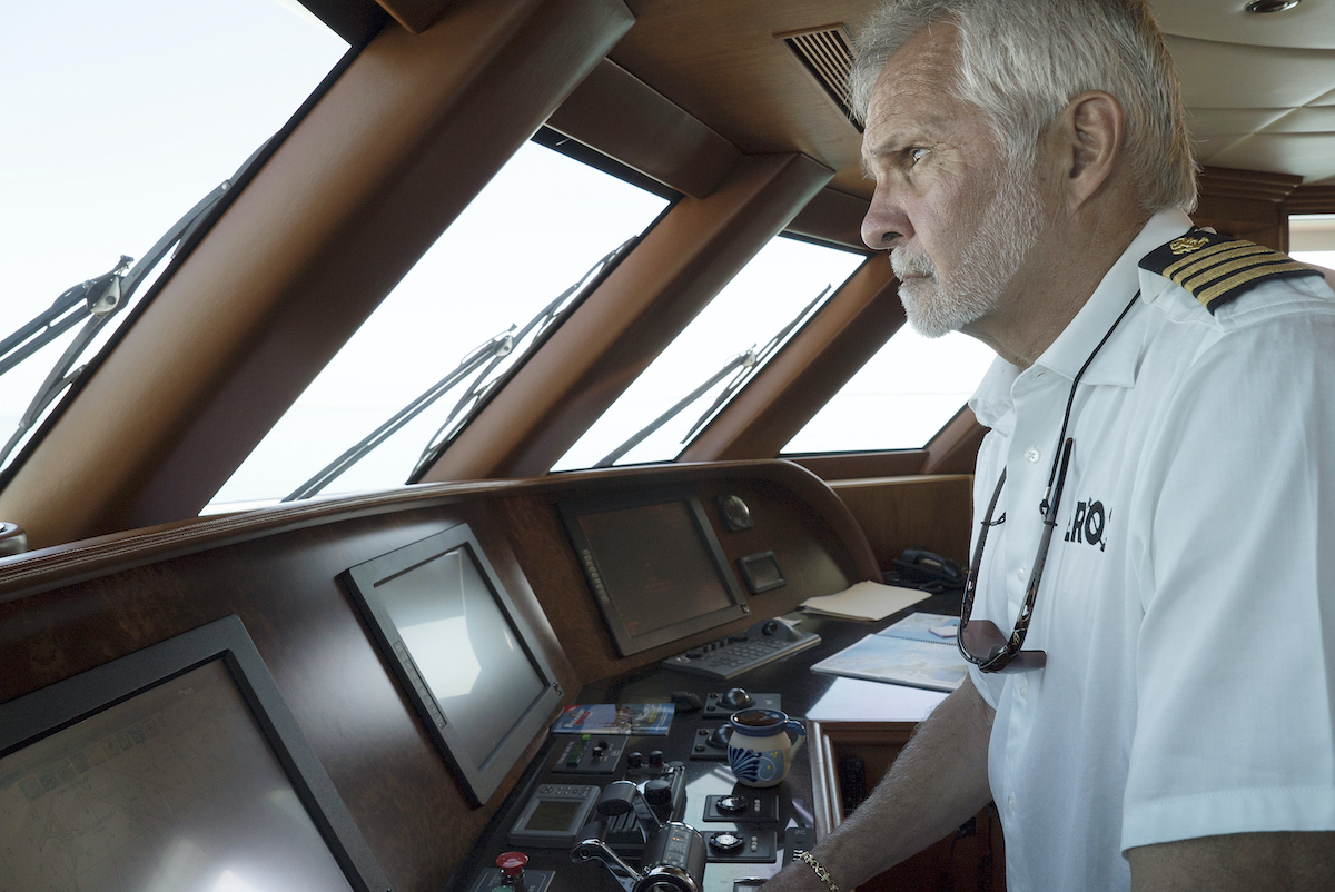Captain Lee Rosbach at the helm.