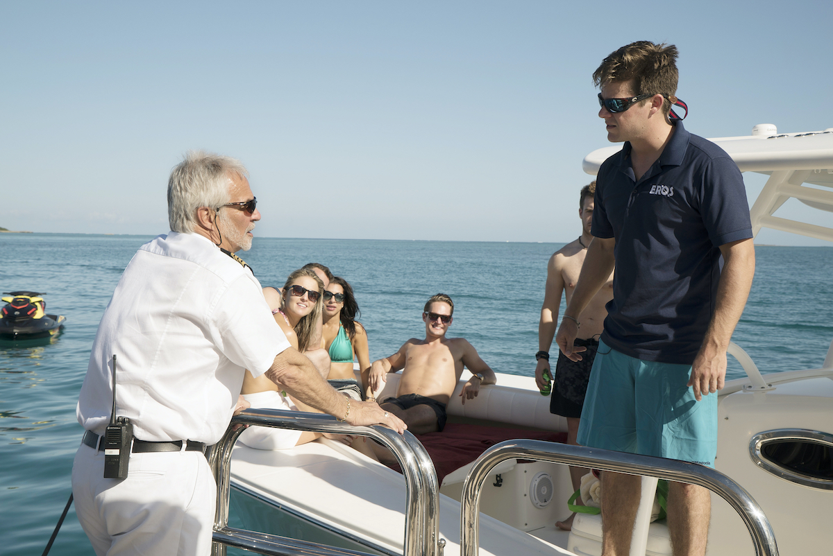 Captain Lee Rosbach, Eddie Lucas have a discussion on a tender.