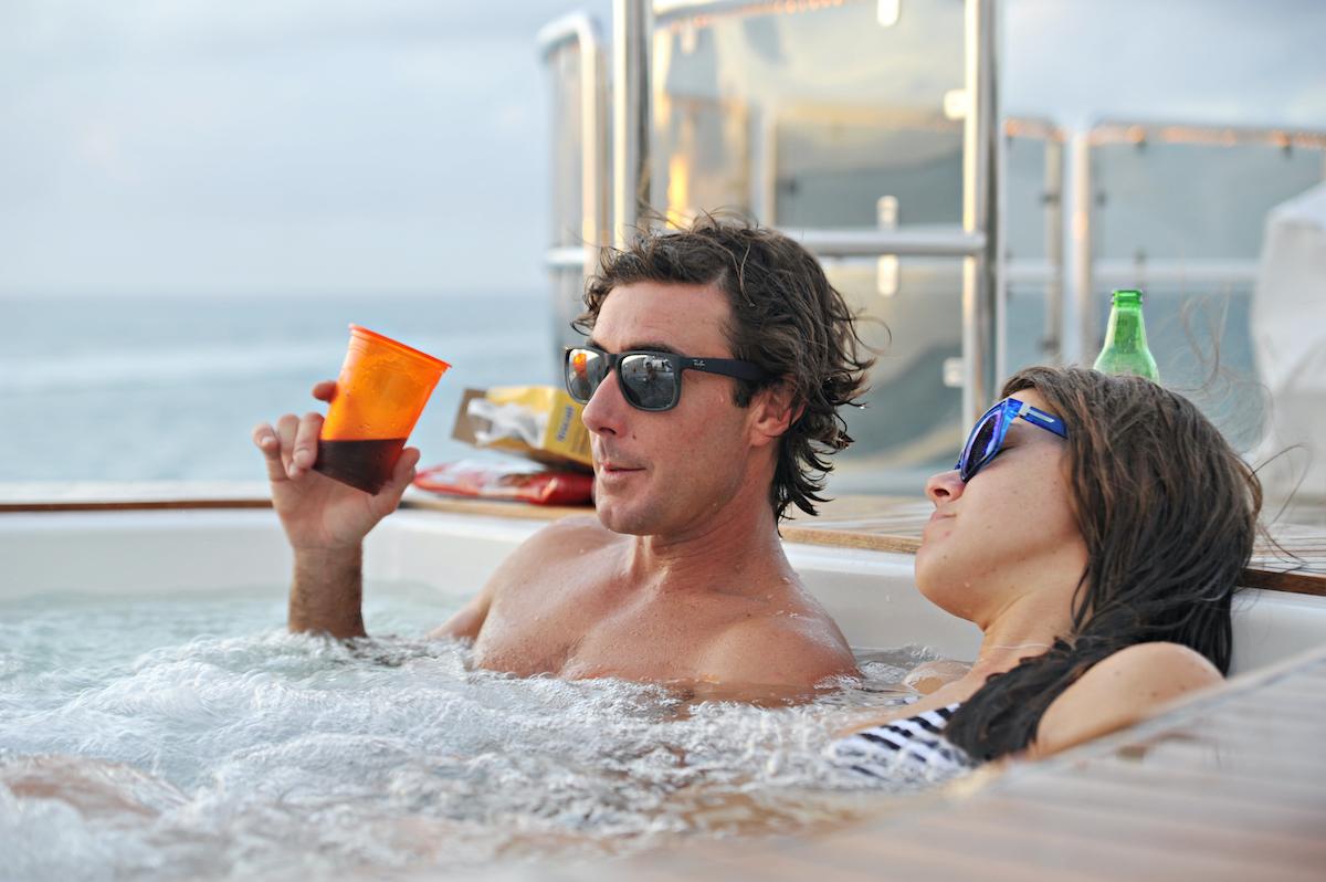 C.J. Lebeau, Samantha Orme relax in a hot tub