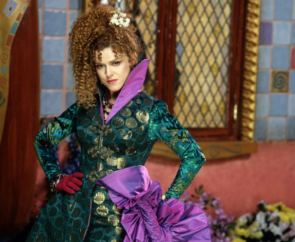 Bernadette Peters in a green and purple gown as the Evil Stepmother in 'Rodgers and Hammerstein's Cinderella' on ABC, 1997 | Disney