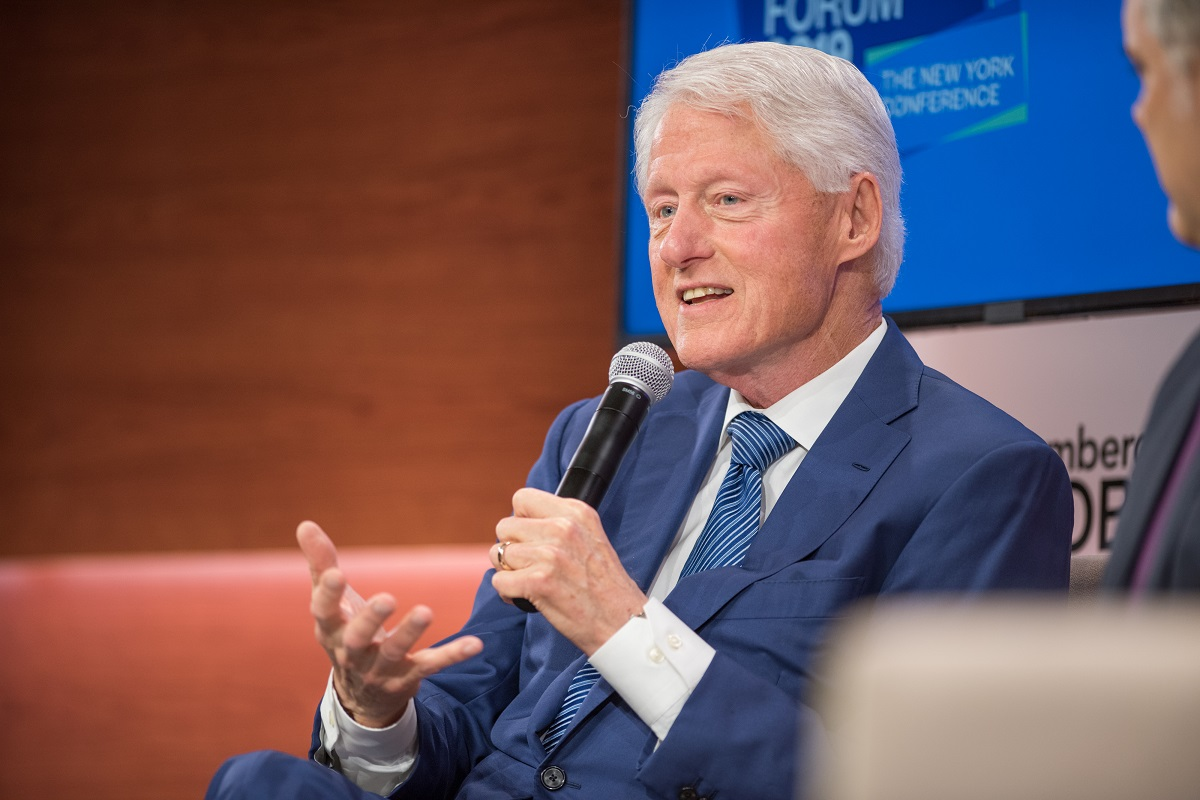 Bill Clinton speaking into a microphone during the Bloomberg Business Week Forum in 2019