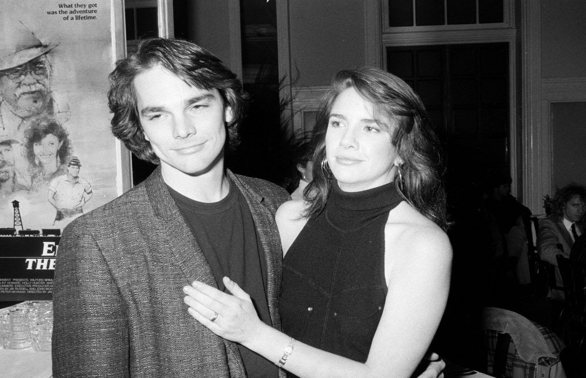 Melissa Gilbert and Bo Brinkman in black and white. Gilbert has her hand on Brinkman's chest as they stand next to each other.