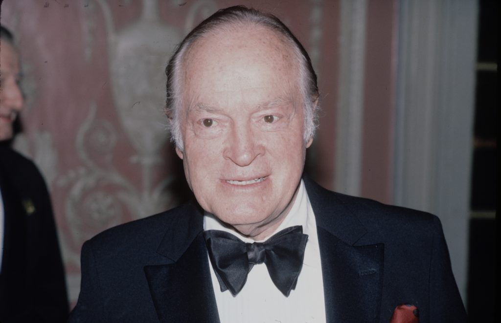 Bob Hope smiling looking to the right in front of a blurred background