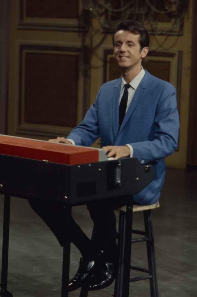 Bob Ralston smiling, playing the piano on 'The Lawrence Welk Show'