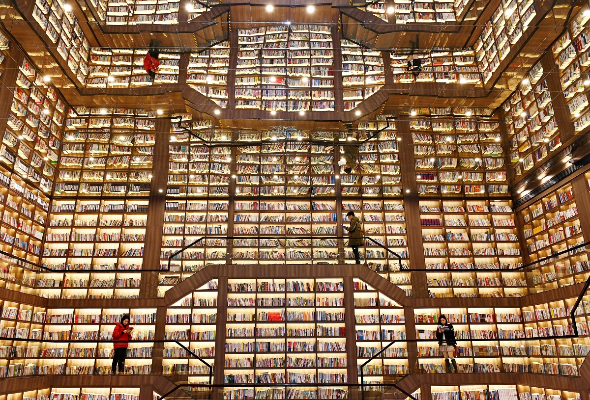 People read books inside the Songpo bookstore during the Spring Festival holiday on February 16, 2021 in Shaoyang, Hunan Province of China.