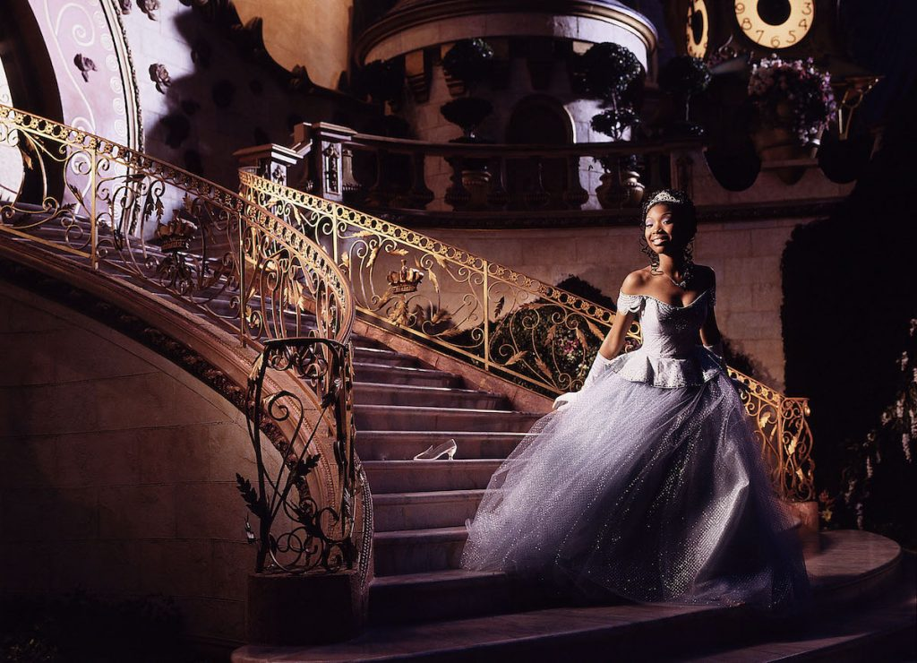 Brandy Norwood in her Cinderella gown on a gilded staircase with a glass slipper behind her in 'Rodgers and Hammerstein's Cinderella' on ABC, 1997   Disney