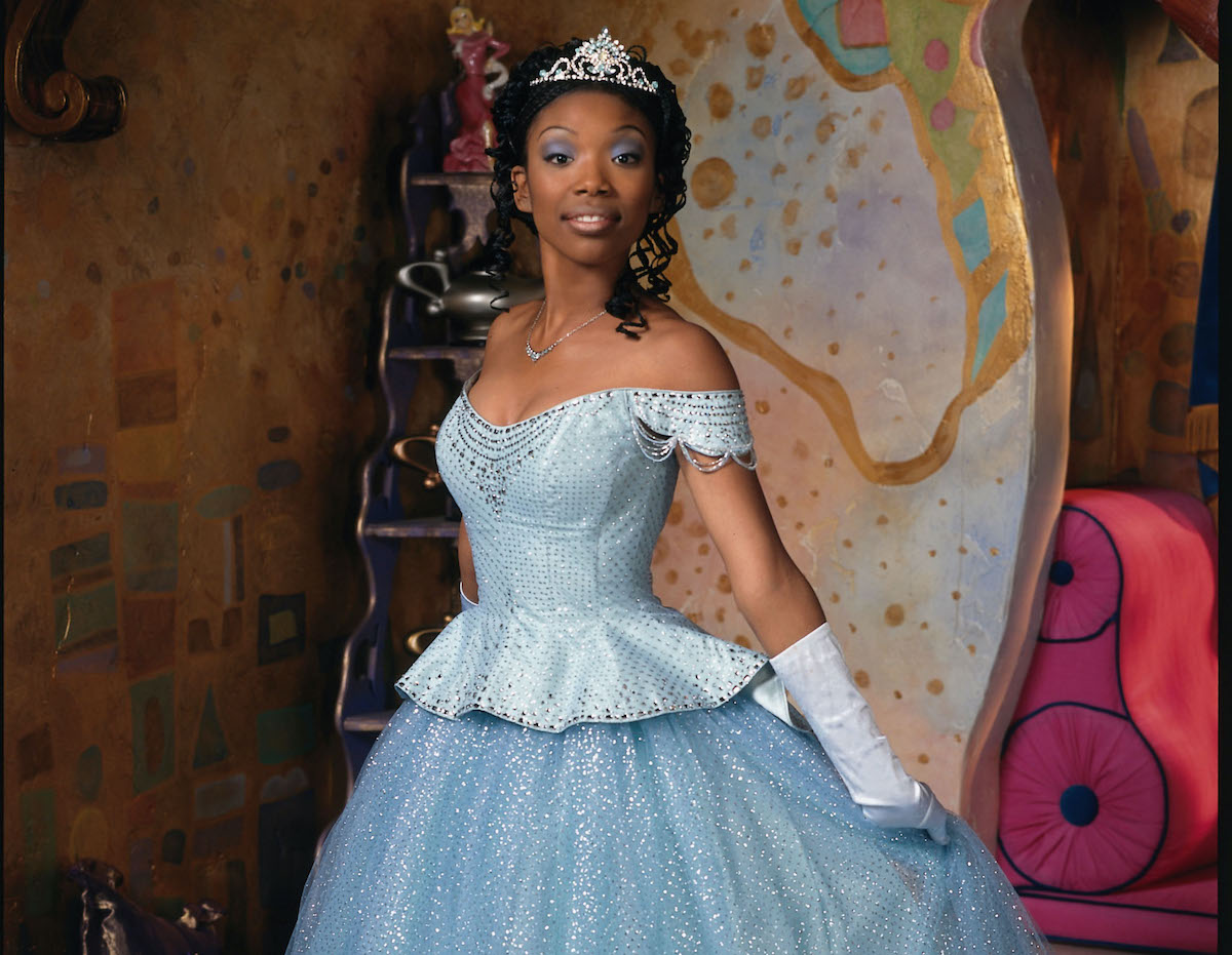 Brandy Norwood in a blue ballgown and tiara as Cinderella in 'Rodgers and Hammerstein's Cinderella' on ABC, 1997. Brandy's Cinderella dress was designed by the same costume designer who created the costumes for Amazon's 'Cinderella' starring Camila Cabello.