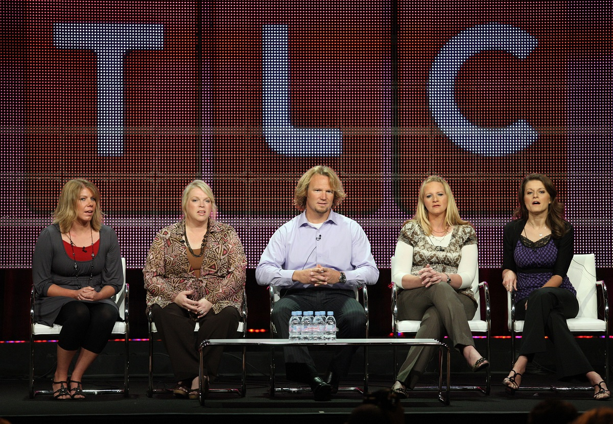 Meri, Janelle, Kody, Christine, and Robyn Brown sitting on a panel at a 2010 TCA Press Tour with a giant TLC logo behind them