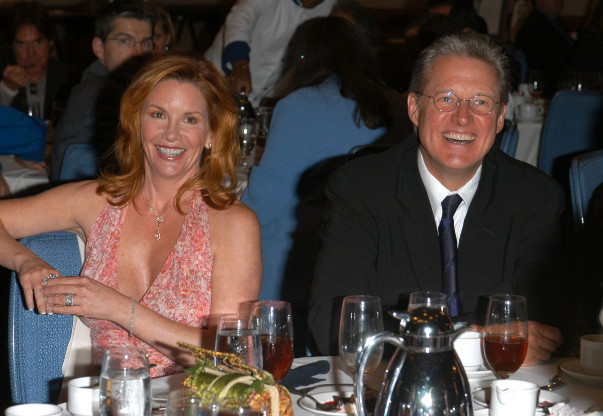 Melissa Gilbert in a pink dress, Bruce Boxleitner in a black suit.