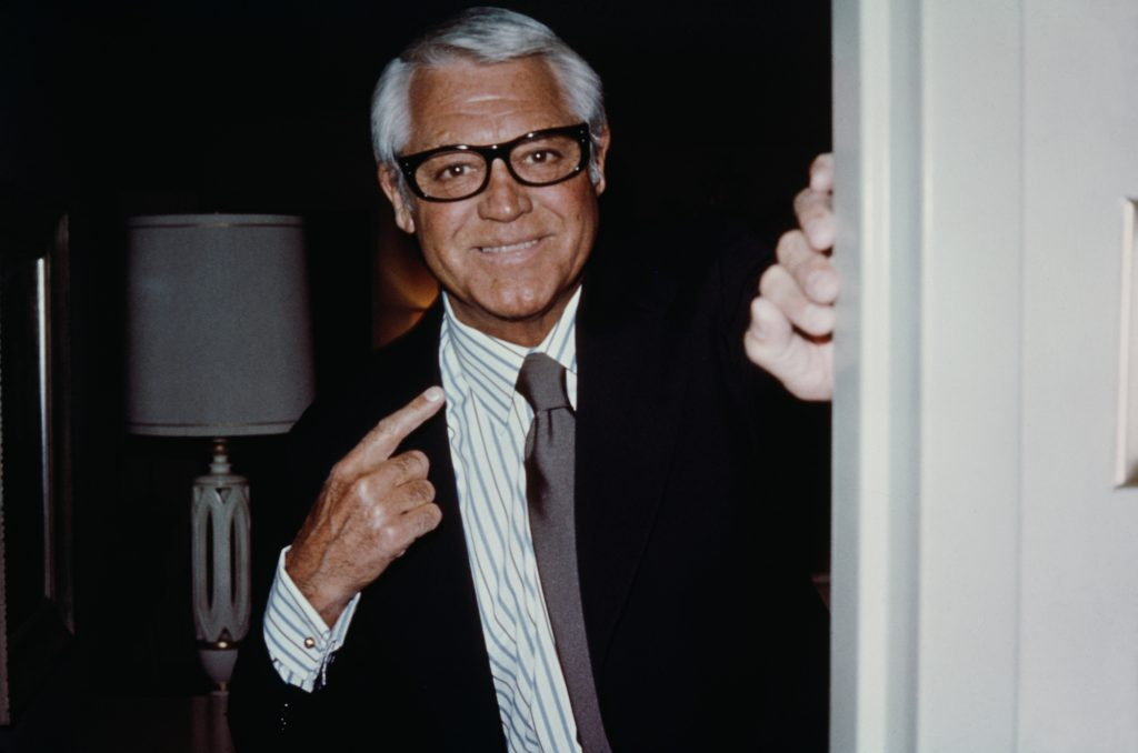 Cary Grant smiling standing in a doorway