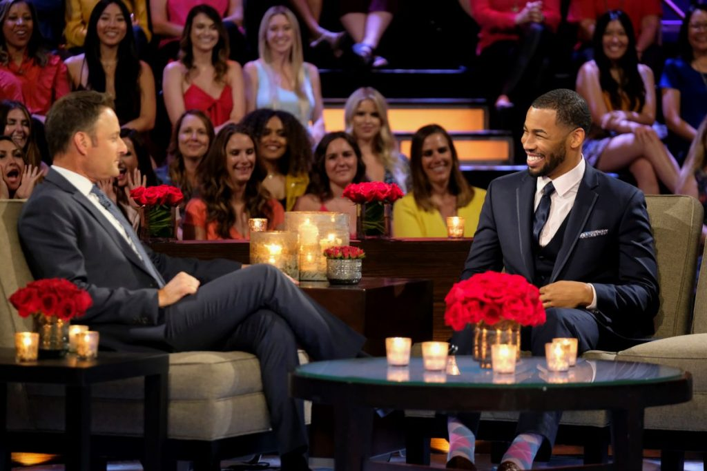 Chris Harrison and Mike Johnson sit onstage at the Men Tell All special of Hannah Brown's season of 'The Bachelorette'