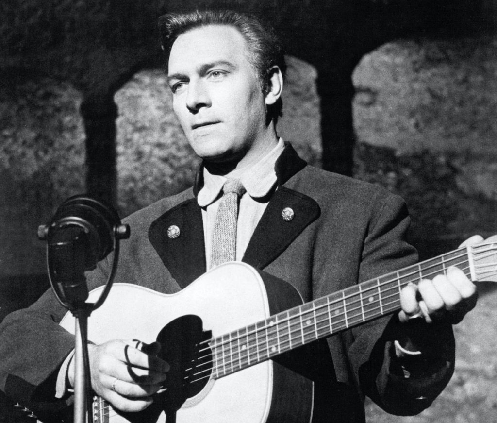 Christopher Plummer, as Captain Georg von Trapp, playing a guitar in 'The Sound of Music' | Silver Screen Collection/Getty Images