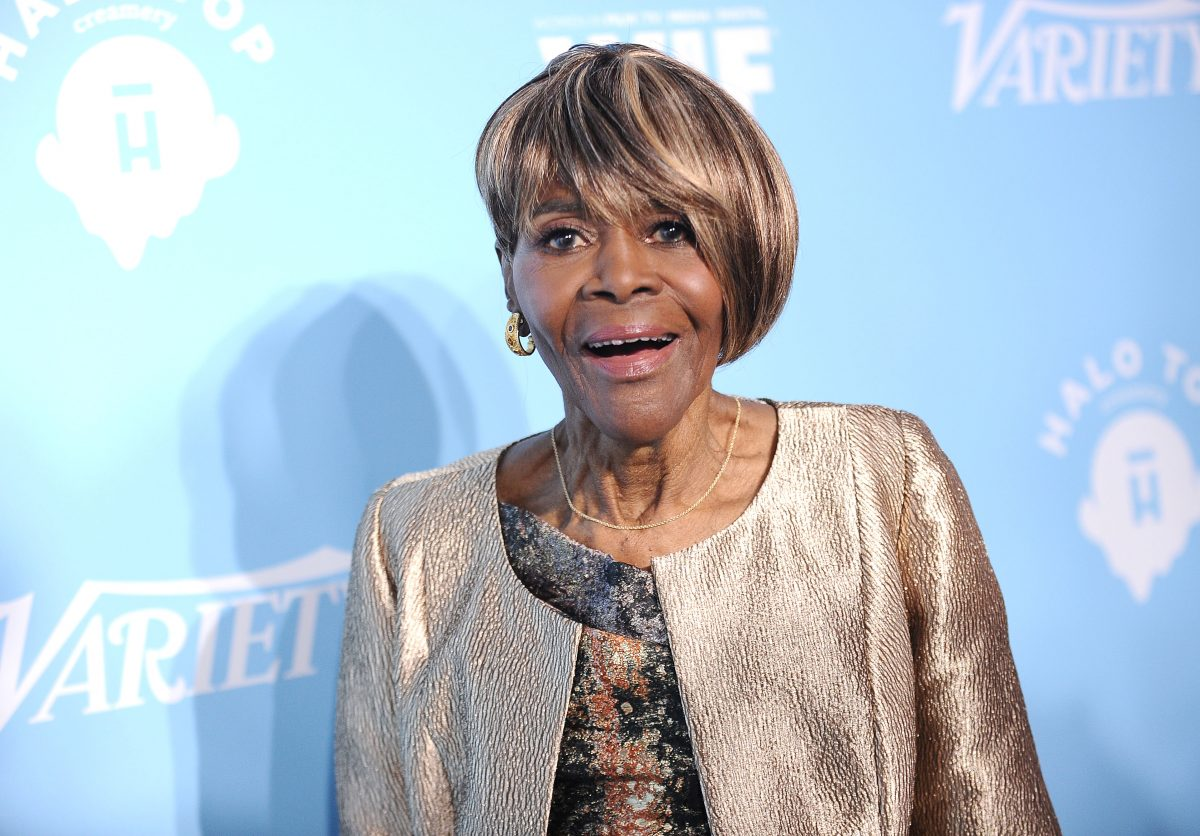 Cicely Tyson wearing a silver jacket.