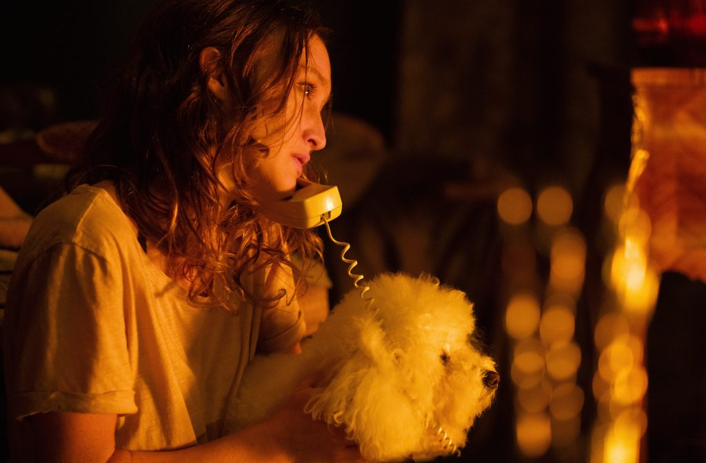 Marnee Carpenter as Catherine Martin talks on a phone and pets a dog on 'Clarice'