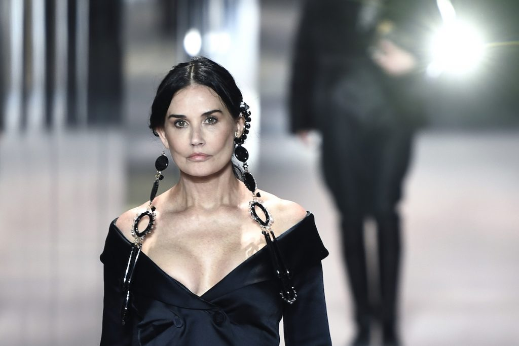 Demi Moore presents a creation of British designer Kim Jones for the Fendi's Spring-Summer 2021 collection during the Paris Haute Couture Fashion Week, in Paris, on January 27, 2021.