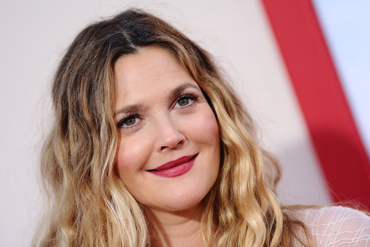 Drew Barrymore smiles for cameras as she arrives at the premiere of 'Blended' in 2014