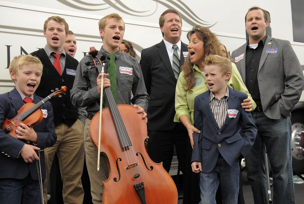 The Duggar family singing together