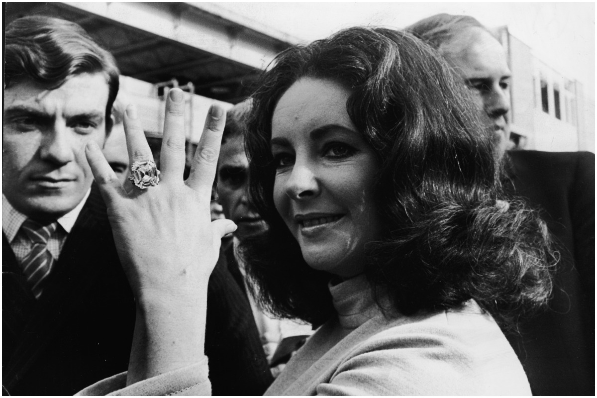 British-born actress Elizabeth Taylor shows off the 33.19 carat diamond ring given to her by husband Richard Burton.